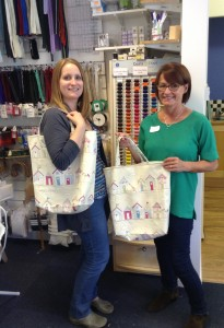 Kaye and Judith modelling their designer totes!